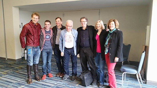 "Tom DeFalco (center left) poses with comics writer and editor Danny Fingeroth (center right) along with ""Star Lord,"" ""Captain America,"" and others."