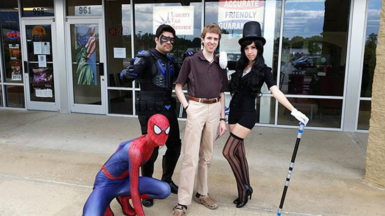 Spider Man, Nightwing, and Zatanna pose with Legendarium Media's A.D. Poole